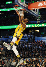 Indiana Pacers' Paul George dunks during the NBA basketball All-Star Slam Dunk contest, Saturday, Feb. 25, 2012, in Orlando, Fla. (AP Photo/Lynne Sladky)