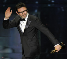 Michel Hazanavicius accepts the Oscar for best director for