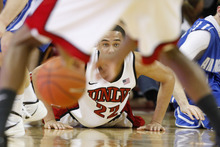 UNLV's Chace Stanback passes the ball from the floor during the second half of an NCAA college basketball game against Air Force, Saturday, Feb. 25, 2012, in Las Vegas. UNLV defeated Air Force 68-58. (AP Photo/Isaac Brekken)
