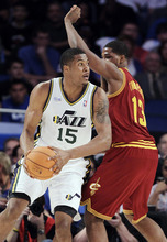 Utah Jazz's Derrick Favors (15), on Team Chuck, drives around Cleveland Cavaliers' Tristan Thompson (13), on Team Shaq, during the NBA All-Star Rising Stars Challenge basketball game in Orlando, Fla. Friday, Feb. 24, 2012. (AP Photo/Chris O'Meara)