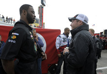 New York Giants NFL football defensive linemen Justin Tuck, left, talks with Jared Erspamer, of Omaha, Neb., while walking through the garage area with teammate Osi Umenyiora, rear center, prior to the NASCAR Daytona 500 Sprint Cup series auto race at Daytona International Speedway in Daytona Beach, Fla., Sunday, Feb. 26, 2012. (AP Photo/Phelan M. Ebenhack)