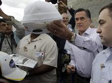 Republican presidential candidate, former Massachusetts Gov. Mitt Romney signs autographs for fans as he visits Daytona International Speedway before the NASCAR Daytona 500 Sprint Cup series auto race in Daytona Beach, Fla., Sunday, Feb. 26, 2012. (AP Photo/John Raoux)