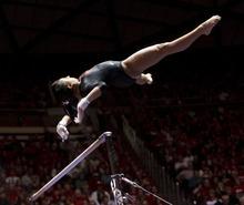 Trent Nelson  |  The Salt Lake Tribune Utah's Kassandra Lopez on the bars. Utah vs. Stanford, college gymnastics, Friday, February 24, 2012 in Salt Lake City, Utah.