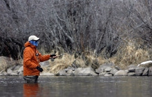 Francisco Kjolseth  |  The Salt Lake Tribune Casting his line in the snow, Ken Barrett visiting from San Antonio, tries his luck on the Middle Provo river near Heber City on Saturday, February 25, 2012, as a storm front begins to move into the area.