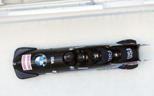 United State's pilot Steven Holcomb, with pushers Justin Olsen, Steven Langton and brakeman Curtis Tomaseviz, compete in the third heat in the men's four-man Bobsled World Championships in Lake Placid, N.Y., on Sunday, Feb. 26, 2012. (AP Photo/Mike Groll)