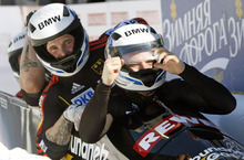 Germany 1 pilot Maximilian Arndt, right, with pushers Alexander Roediger, Kevin Kuske and brakeman Martin Putze, react after their second-place finish in the men's four-man Bobsled World Championships in Lake Placid, N.Y., on Sunday, Feb. 26, 2012. (AP Photo/Mike Groll)