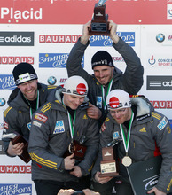 Germany 2's men's four-man team poses after their third-place finish in the bobsled world championships in Lake Placid, N.Y., on Sunday, Feb. 26, 2012.  From left to right, are: Marko Huebenbecker, Christian Poser, Andreas Bredau and Manuel Machata. (AP Photo/Mike Groll)