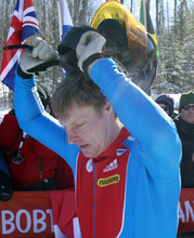 Russia's Alexsandr Zubkov takes off his helmet after his team's fifth-place finish in the men's four-man bobsled world championships in Lake Placid, N.Y., Sunday, Feb. 26, 2012. (AP Photo/Mike Groll)
