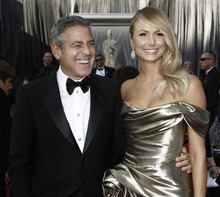 George Clooney, left, and Stacy Keibler arrive before the 84th Academy Awards on Sunday, Feb. 26, 2012, in the Hollywood section of Los Angeles. (AP Photo/Matt Sayles)