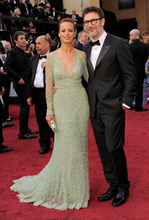 Berenice Bejo, left, and Michel Hazanavicius arrive before the 84th Academy Awards on Sunday, Feb. 26, 2012, in the Hollywood section of Los Angeles. (AP Photo/Chris Pizzello)