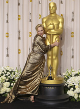 CORRECTS NAME TO STREEP -- Meryl Streep poses with her award for best actress for
