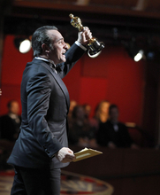 Jean Dujardin accepts the Oscar for best picture for