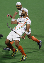 India's Sandeep Singh, front, celebrates with teammate Gurwinder Singh Chandi after scoring India's third goal against France during the 1st-2nd placed playoff match of field hockey Olympic qualifier in New Delhi, India, Sunday, Feb. 26, 2012. (AP Photo/Saurabh Das)