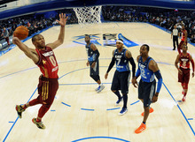 Western Conference's Russell Westbrook (0), of the Oklahoma City Thunder, elevates for a dunk past Eastern Conference's Dwyane Wade (3), of the Miami Heat, Carmelo Anthony (7), of the New York Knicks, Dwight Howard (12), of the Orlando Magic, and Western Conference's Chris Paul (3), of the Los Angeles Clippers, during the first half of the NBA All-Star basketball game, Sunday, Feb. 26, 2012, in Orlando, Fla. (AP Photo/Erik S. Lesser, Pool)