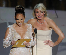 Jennifer Lopez, left, and Cameron Diaz present an award during the 84th Academy Awards on Sunday, Feb. 26, 2012, in the Hollywood section of Los Angeles. (AP Photo/Mark J. Terrill)