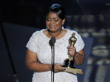 Octavia Spencer accepts the Oscar for best actress in a supporting role for