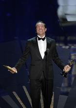 Jean Dujardin accepts the Oscar for best actor in a leading role for