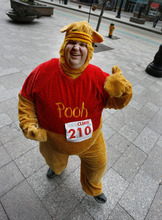 Scott Sommerdorf  |  The Salt Lake Tribune              Jason Berrett poses in his Pooh Bear costume before his run to the 23rd floor of the Wells Fargo Building during The American Lung Association's seventh-annual Fight for Air Climb, Saturday February 25, 2012.