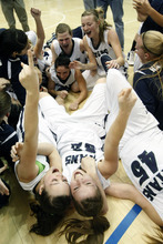Chris Detrick  |  The Salt Lake Tribune Members of the Syracuse basketball team celebrate after winning the 5A championship game at Salt Lake Community College Saturday to cap an undefeated season. It is the Titans' second state title in three years.