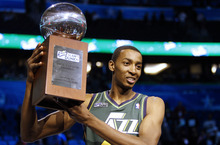 Utah Jazz's Jeremy Evans holds up the trophy after winning the NBA basketball All-Star Slam Dunk contest, Saturday, Feb. 25, 2012, in Orlando, Fla. (AP Photo/Lynne Sladky)