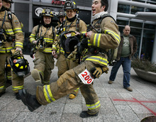 Scott Sommerdorf  |  The Salt Lake Tribune              Justin Leavitt of the South Salt Lake Fire Department does a high-stepping dance to warm up with other members of his squad prior to the American Lung Association's seventh-annual Fight for Air Climb, Saturday February 25, 2012.