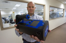 Steve Griffin  |  The Salt Lake Tribune   Rob Harmon, director of business development at D-Tect Systems, holds a rad-ID radiation identifier at company headquarters in Draper, Utah Friday, September 23, 2011.  D-Tect Systems is a small but surging company that manufactures radiation and chemical detection systems for homeland security, police, firefighters and others. It's seen sales soar since 9/11. Its products are used by FDA, FBI, NYPD, Department of Defense, US Army and Air Force as well as the Department of Homeland Security.