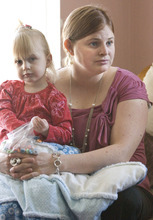Paul Fraughton | The Salt Lake Tribune. Camilla Grondahl holds her daughter Chloe as she talks about the genetic mutation she has in common with her mother that caused her infant son Max to be born with what is now named Ogden Syndrome.  Tuesday, February 14, 2012