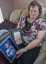 Paul Fraughton | The Salt Lake Tribune. Halena Black shows photos of her sons Hyrum ,left, born in 1987 and Kenny Rae, born in 1979. Both boys died in infancy from what is now being termed Ogden Syndrome.  Tuesday, February 14, 2012
