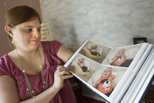 Paul Fraughton | The Salt Lake Tribune. Camilla Grondhal looks through a scrap book of photos of her son Max, who died from a genetically transmitted condition named Ogden Syndrome  Tuesday, February 14, 2012