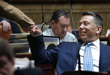 Scott Sommerdorf  |  The Salt Lake Tribune              Rep. Stephen Sandstrom, R-Orem, fist-bumls with Rep. Richard Greenwood, R-Roy, after the passing of HB395 - Firearms Amendments - sponsored by Sandstrom, in the Utah House of Representatives, Monday, February 27, 2012.