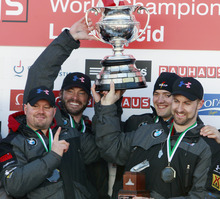 United States' men's four-man bobsled team holds the Martineau Cup after winning the bobsled world championships in Lake Placid, N.Y., on Sunday, Feb. 26, 2012.  From left to right, are: Steven Holcomb, Steven Langton, Justin Olsen and Curtis Tomasevicz. (AP Photo/Mike Groll)