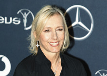 FILE - In this Feb. 6, 2012 file photo, former tennis player Martina Navratilova, arrives for the Laureus World Sports Awards in London. Navratilova will be among the 12 celebrity contestants on the next season of the ABC dancing competition, premiering March 19. (AP Photo/Lefteris Pitarakis, file)