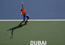Andy Murray of Great Britain serves the ball to Michael Berrer of Germany during the Emirates Dubai ATP Tennis Championships in Dubai, United Arab Emirates, Tuesday, Feb. 28, 2012. (AP Photo/Hassan Ammar)