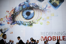 Participants attend the Mobile World Congress, the world's largest mobile phone trade show, in Barcelona, Spain, Monday, Feb. 27, 2012. (AP Photo/Manu Fernandez)