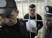Former Ukrainian Interior Affair Minister Yuriy Lutsenko is seen in a detention cage in a courtroom, in Kiev, Ukraine, Monday, Feb. 27, 2012. Kiev district court on Monday has sentenced Ukraine's former interior minister in the government of jailed ex-premier Yulia Tymoshenko to four years in prison on charges of embezzling and abuse of office. Yuriy Lutsenko will stay in jail for two years and ten months since he has already been under arrest for one year and two months.(AP Photo/Sergei Chuzavkov)