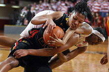 Maryland's Alyssa Thomas (25) and North Carolina State's Krystal Barrett tussle for the ball during the first half of an NCAA college basketball game in Raleigh, N.C., Sunday, Feb. 26, 2012. Maryland won 65-50. (AP Photo/Karl B DeBlaker)