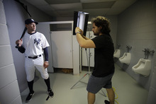 New York Yankees' Alex Rodriguez, left, poses for photographer Nick Laham on photo day during baseball spring training, Monday, Feb. 27, 2012, in Tampa, Fla. (AP Photo/Matt Slocum)