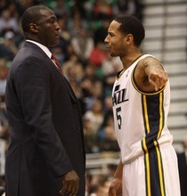 Rick Egan  | The Salt Lake Tribune   Utah Jazz head coach Tyrone Corbin chats with Utah Jazz point guard Devin Harris during a free throw in Salt Lake City, Monday, February 20.