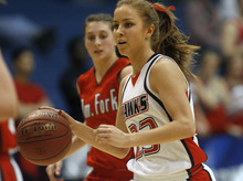 Chris Detrick  |  The Salt Lake Tribune Alta's Makenzi Morrison (23) runs past American Fork's Cassidy Fraughton (5) during the game at Salt Lake Community College Thursday February 23, 2012. American Fork won the game 56-51.