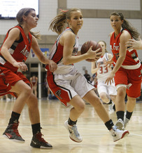 Chris Detrick  |  The Salt Lake Tribune Alta's Makenzi Morrison (23) runs through American Fork's Megan  Eliason (23) and American Fork's Sadie Williams (12) during the game at Salt Lake Community College Thursday February 23, 2012. American Fork won the game 56-51.