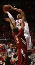 Kim Raff  |  The Salt Lake Tribune University of Utah player Cedric Martin takes a shot over the head of Stanford player Aaron Bright at the Huntsman Center in Salt Lake City, Utah on February 25, 2012. Utah went on to win 58-57.