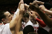 Kim Raff  |  The Salt Lake Tribune University of Utah players celebrate beating Stanford 58-57 at the Huntsman Center in Salt Lake City, Utah on February 25, 2012.