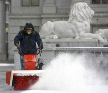 Al Hartmann     The Salt Lake Tribune Bob Steffen, of the Utah State Capitol Grounds Department snow blows the east side entrance Tuesday morning February 28.