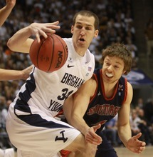 Rick Egan  | The Salt Lake Tribune   Brigham Young Cougars forward Noah Hartsock (34) grabs a rebound as St. Mary's Gaels guard Matthew Dellavedova (4) defends,  in basketball action, BYU vs. St Mary's in the Marriott Center in Provo, Saturday, January 28, 2012.