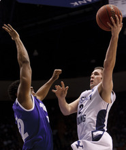 Trent Nelson  |  The Salt Lake Tribune BYU guard Craig Cusick (2) shoots the ball, defended by Portland forward Dorian Cason (22). BYU vs. Portland, college basketball Saturday, February 25, 2012 in Provo, Utah.