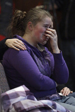 Alissa Sully, 17, cries during a prayer service for victims of a school shooting at Chardon Assembly of God in Chardon, Ohio Monday, Feb. 27, 2012. A gunman opened fire inside the high school's cafeteria at the start of the school day Monday, killing one student and wounding four others.  (AP Photo/Mark Duncan)