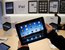 Paul Sakuma  |  Associated Press file photo The gap between Apple and No. 2 Exxon Mobil Corp. has widened rapidly in the past month, as investors have digested Apple's report of blow-out holiday-season sales of iPhones and iPads.
