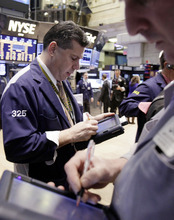 file  |  The Associated Press Traders work on the floor of the New York Stock Exchange. Now that the Dow Jones industrial average has closed near 13,000, an all-time high is only about 1,200 points away. But the coast is not quite clear for the markets or the economy.