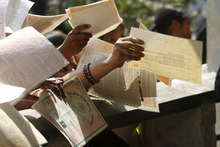Unemployed Indian women hold out forms as they crowd at the Employment Exchange Office (EEO) in Allahabad, India, Wednesday, Feb. 29, 2012. The state government office offers job placement to the registered unemployed applicants when positions become available.(AP Photo/Rajesh Kumar Singh)