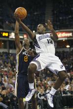 Sacramento Kings guard Tyreke Evans (13) drives to the basket against Utah Jazz defender Josh Howard (8) during the second half of an NBA basketball game in Sacramento, Calif., Tuesday, Feb. 28, 2012. The Kings won 103-96.(AP Photo/Steve Yeater)